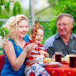 Happy family on weekend home party — Stock Photo