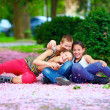 Happy teenage kids having fun in spring park — Stock Photo