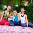 Happy teenage kids having fun in spring park — Stock Photo #26052289