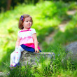 Baby girl portrait, colorful park — Stock Photo #26107637