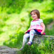 Happy baby girl portrait, colorful outdoors — Stock Photo #26107639