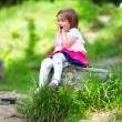 Happy baby girl in spring park — Stock Photo #26107661
