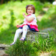 Happy baby girl in spring park — Stock Photo #26107663