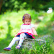 Baby girl portrait in spring park — Stock Photo