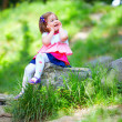 Happy baby girl in spring park — Stock Photo #26107697