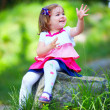 Happy baby girl portrait, colorful park — Stock Photo #26107699