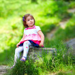 Baby girl portrait, colorful outdoors — Stock Photo