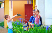 Small kids with toy gun playing in war, colorful outdoor — Stock Photo