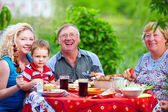 Happy family together in picnic, colorful outdoors — Stock Photo