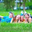 Happy teenage friends having fun in spring park — Stock Photo #26201791
