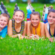 Happy teenage friends having fun in spring park — Stock Photo #26201877