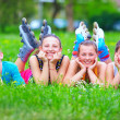 Happy teenage friends having fun in spring park — Stock Photo