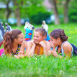 Stock Photo: Happy teenage friends having fun in spring park