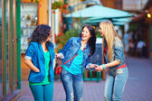 Happy laughing friends on evening street — Stock Photo
