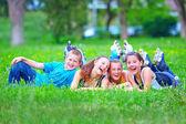 Happy teenage friends having fun in spring park — Stock Photo