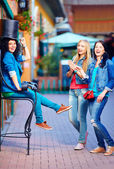 Happy friends having fun in the old city street — Stock Photo