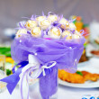 Sweet candy flower bouquet on setting table — Stock Photo
