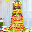 Colorful fruit pyramid on banquet — Stock Photo