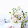 Delicate wedding bouquet with invitation card — Stock Photo