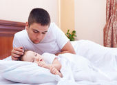 Father watching the son sleeps, home indoors — Stock Photo