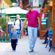 Happy father and son walking the city street — Stock Photo