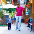 Father and baby boy walking the city street — Stock Photo #26507487