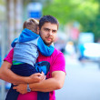 Candid image of father with son walking the ctreet — Stock Photo #26577071