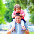 Happy father and daughter having fun in park — Stock Photo