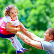 Happy father and baby girl having fun in park — Stock Photo