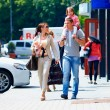 Family walking the city street, casual lifestyle — Stock Photo #26634297