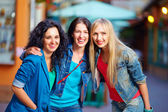 Beautiful girls friends on evening city street — Stockfoto