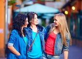 Beautiful girls friends on evening city street — 图库照片