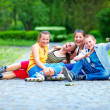 Happy teenage friends playing outdoors — Stock Photo #26916227
