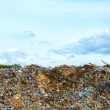 Tons of plastic waste on sky background — Stock Photo