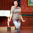 Beautiful adult woman dancing indoors — Stock Photo