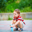 Small kid painting the ground with chalk — Stock Photo