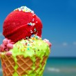 Tasty melting ice cream on summer background — Stock Photo