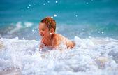 Happy boy kid having fun in sea water — Stock Photo