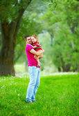 Happy father and son playing outdoors in spring forest — Stock Photo