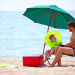Father and son relaxing on sea beach — Stock Photo #29843393