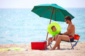Father and son relaxing on sea beach — Stock Photo