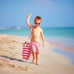Cute kid boy walking the sea beach — Stock Photo #30064591