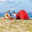 Happy family camping in mountains — Stock Photo