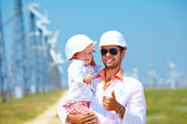 Father and son on wind power station — Stock Photo