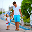 Father and son walking colorful city street, shopping — Stock Photo