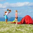 Happy family camping in mountains — Stockfoto #30560869
