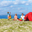 Foto de Stock  : Happy family camping in mountains