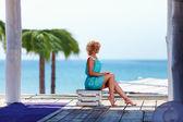 Beautiful girl near the seaside, summer memories — Stock Photo