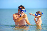 Happy father and son snorkeling — Stock Photo