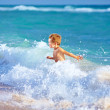 Cute kid boy having fun in sea surf — Stock Photo